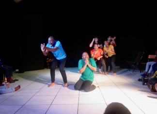 Scene from Maimane!, performed by the Ensemble of Drama For Life Theatre Company and directed by Warren Nebe