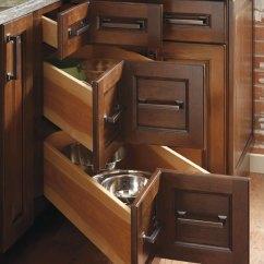 Kitchen Cabinets.com Elegant Curtains Valances Three Drawer Corner Cabinet - Diamond Cabinetry