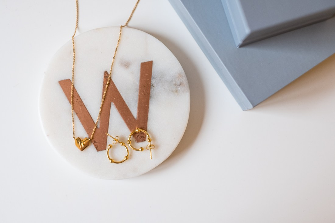 Missoma folded heart engraved necklace and gold hoop earrings and boxes