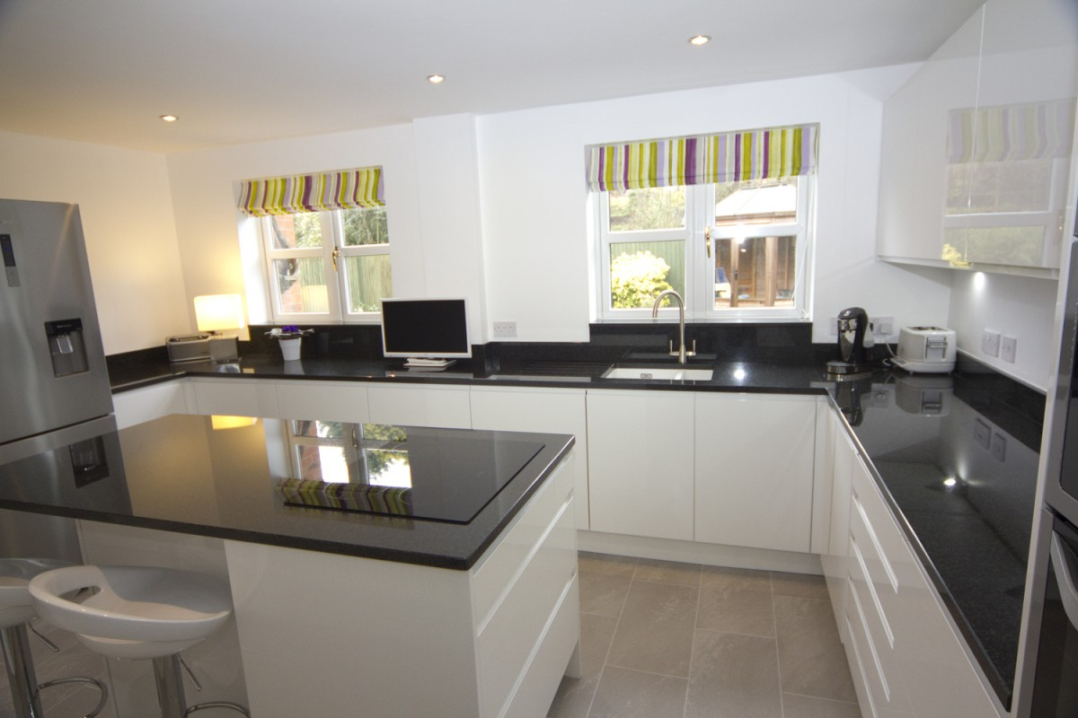 White Gloss Kitchen with Black Granite Worktops Worcester