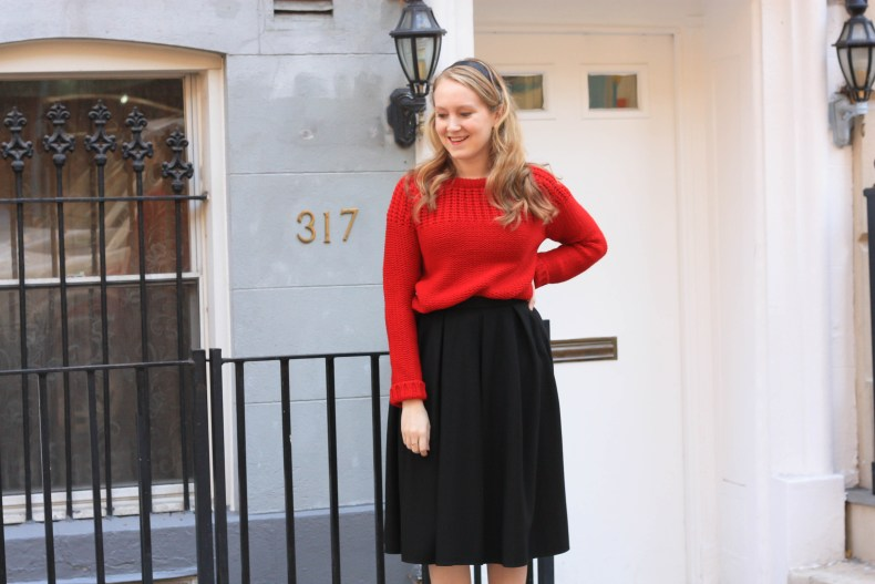 Fashion blogger Diana Pearl of Pearl Girl shares a Christmas outfit in a red sweater and black midi skirt from ASOS