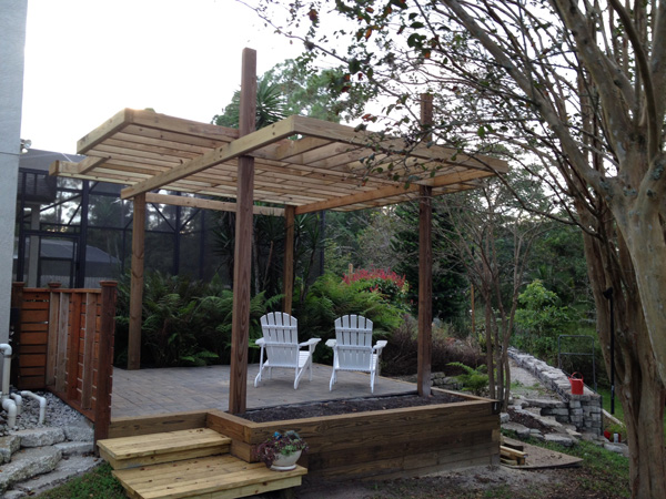 Raised paver patio with cantilevered pergola