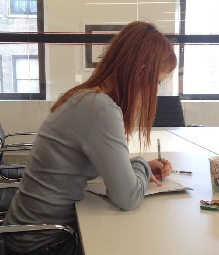 Diane Pagen writing on her desk