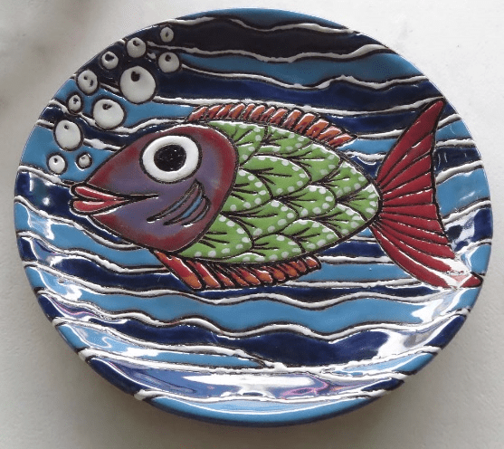 Ceramic plate with whimsical fish