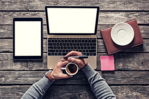 computer-coffee-cup-tablet-hands