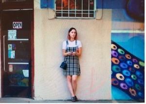 schoolgirl in front of building