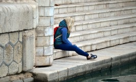 Understanding sexual abuse image shows a girl thinking on steps