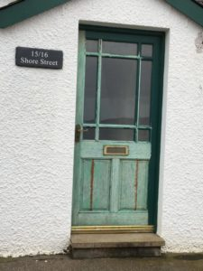 Scotland vs. America: Image of a celadon front door in Applecross.