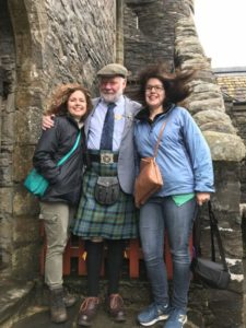 Scotland vs. America image of me, Megan Wright, and Eilean Donan castle volunteer, Mr. McCleod.