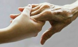 agingparents101: image of young female hand holding older hand