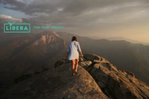 Do Yourself a Favor: Thoughts on Self-Care and Self-Love: Image of a woman walking on top of a mountain.
