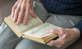 Learning How to Age Faith Matters Post: image of elderly woman's hands with Bible.