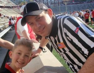 Make It, Official: Image of adult father football official with young son.