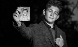 BoyMeetsWorld: Image of high school boy holding a photo of kindergarten boy.