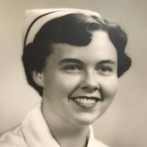 Mother daughter: Image of a young woman in a nurse's uniform and cap.