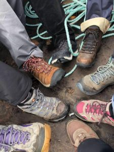 Scotland Revisited: image of seven hiking boots in a circle.