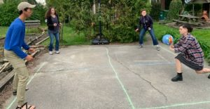 Adult kids: Image of mother with three adult kids playing four square.