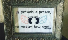 "What to expect when you have a miscarriage: Image of a cross stitch sampler that says, ""A person's a person, no matter how small."""