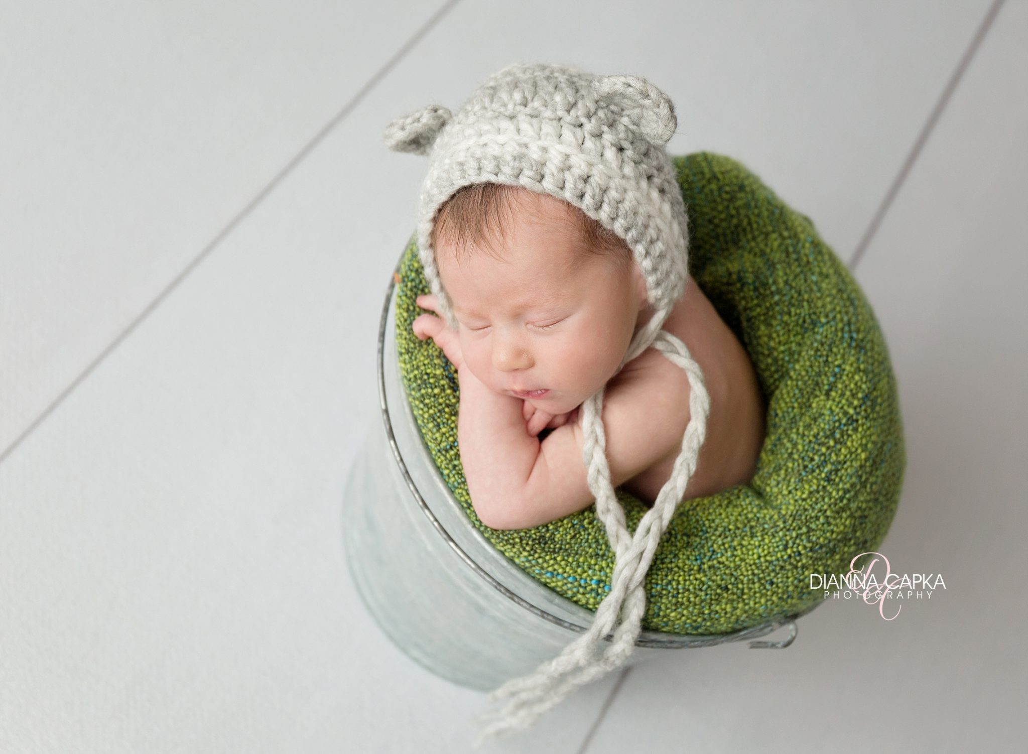 Newborn boy lancaster baby photographer green and gray with a bear bonnet