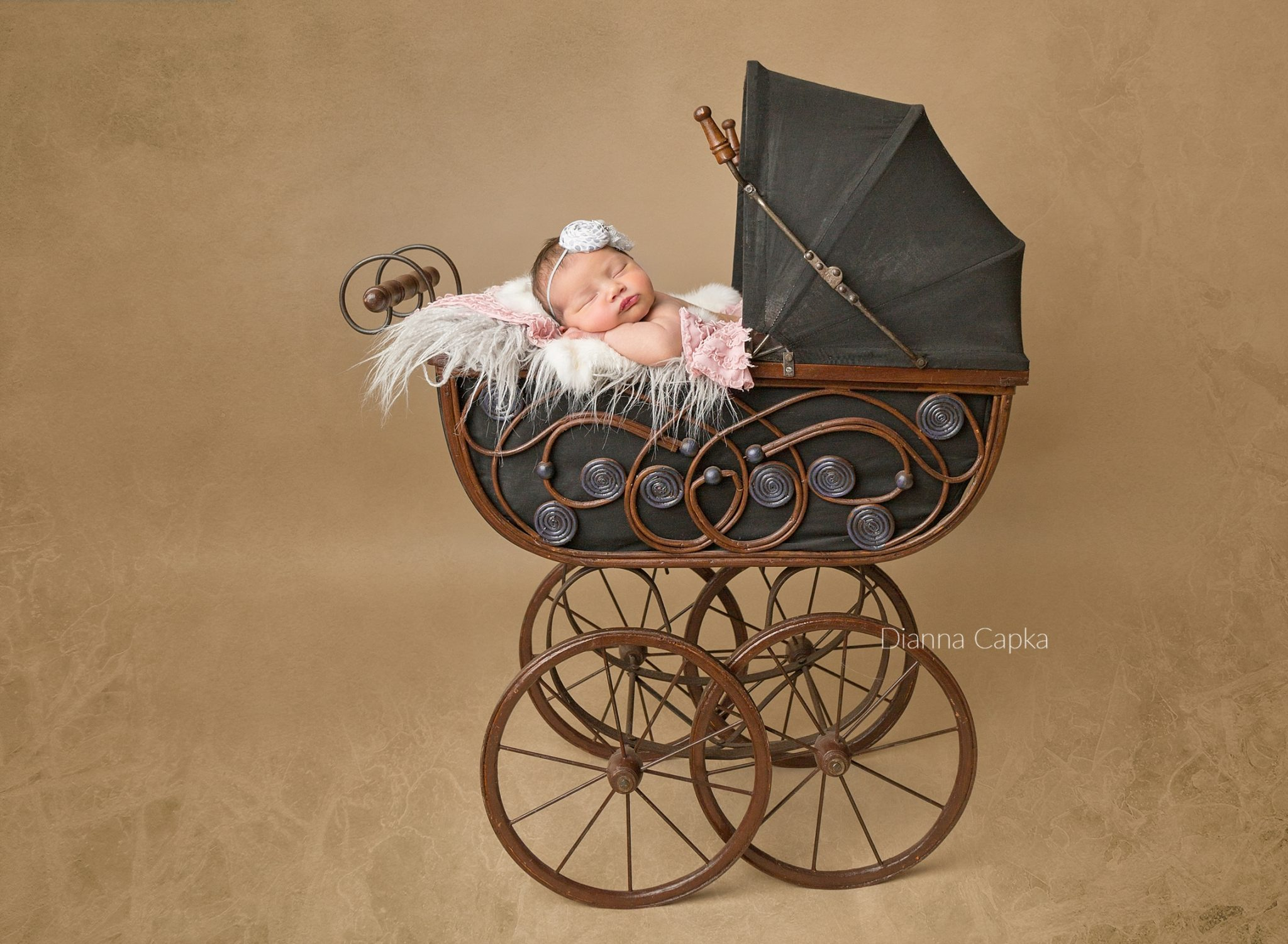 Vintage carriage with newborn girl