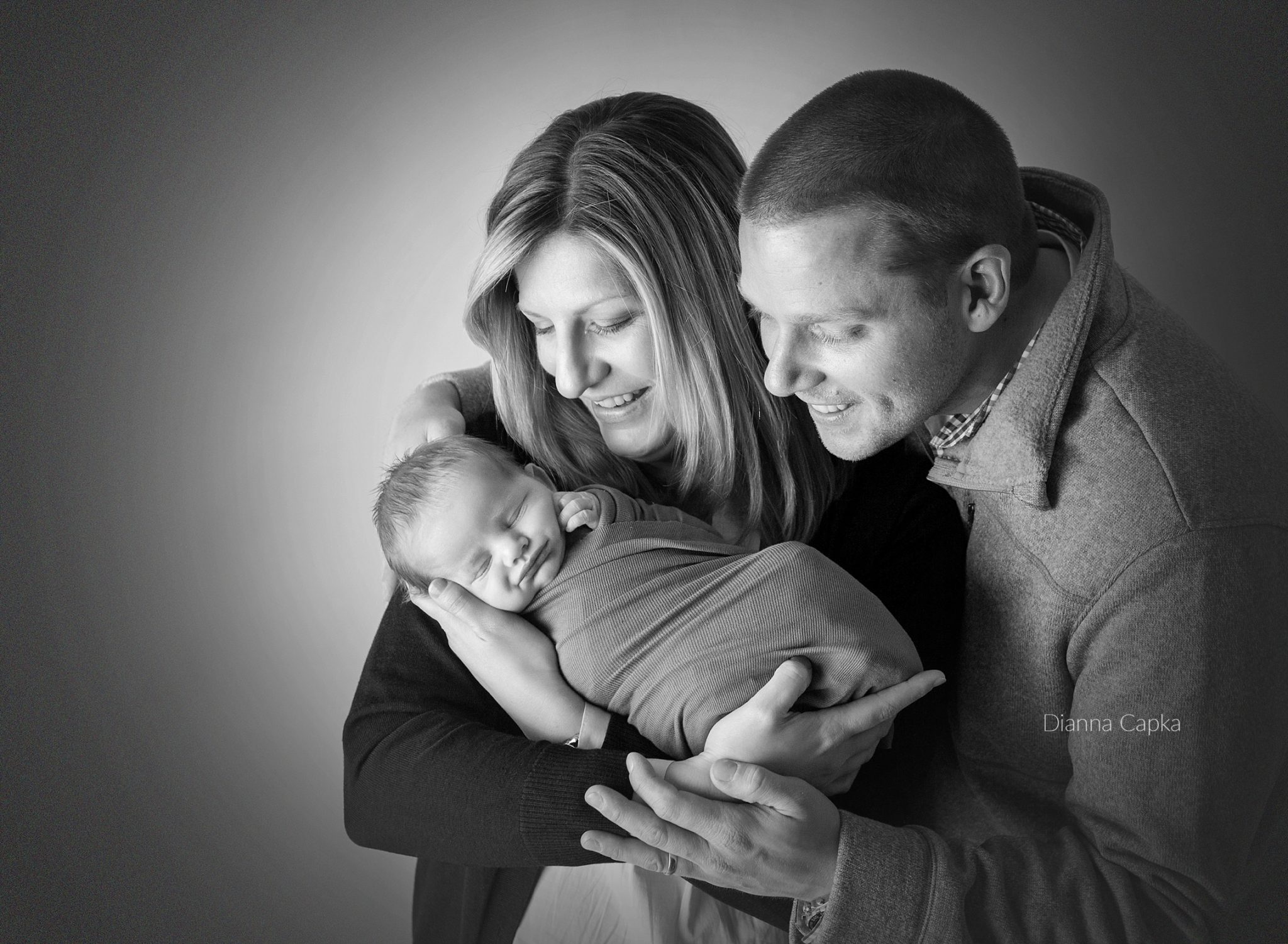 Parents with newborn studio portrait photography