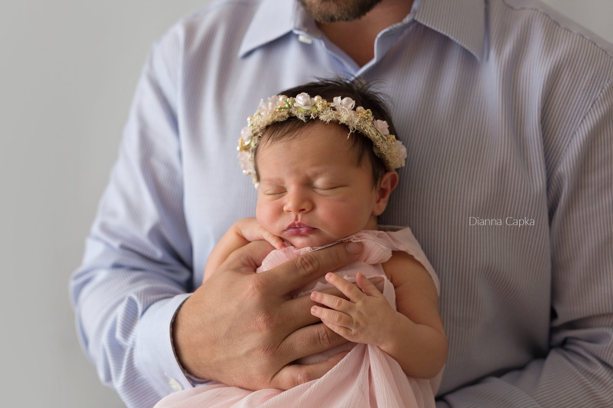 newborn girl in daddy's arms lancaster baby photographer