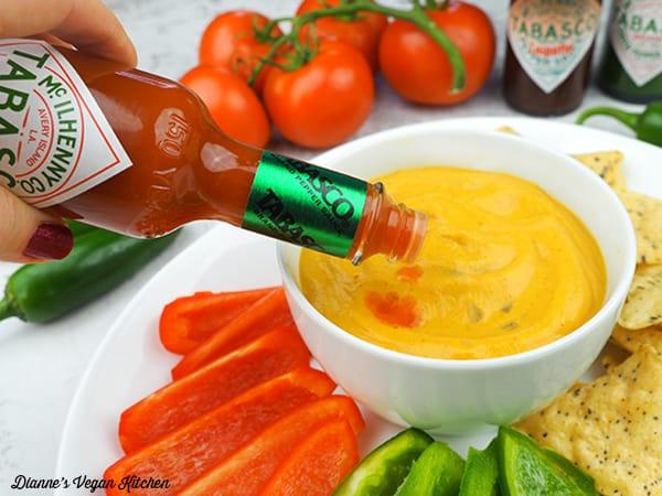 Adding TABASCO® to Vegan Queso