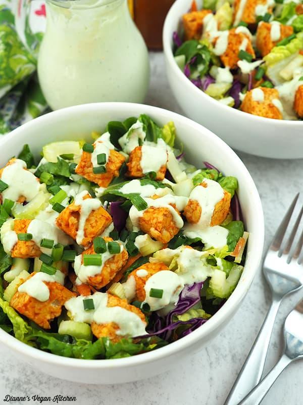 two bowls of buffalo tempeh salad