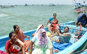 Trouble at sea: In spite of a court order and heavy police presence, large number of women and youth arrived in boats to register their protest | Photo: The New Indian Express