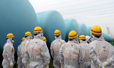 Members of the Japan Nuclear Regulation Authority inspect makeshift water storage tanks at the Fukushima nuclear power plant. Photograph: Japan Nuclear Regulation/EPA
