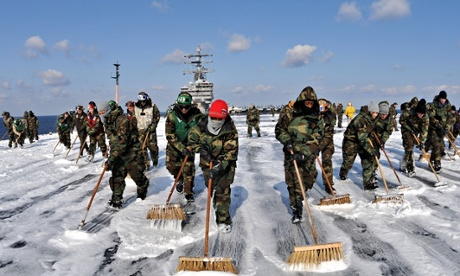 Sailors scrub the deck of the USS Ronald Reagan to remove potential radiation contamination following the Fukushima nuclear disaster. Photograph: Handout/Getty Images