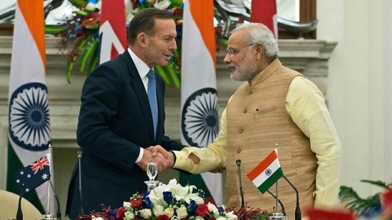 Indian Prime Minister Narendra Modi (R) shakes hands with Australian Prime Minister Tony Abbott after a signing ceremony for the Agreement of Cooperation in the Peaceful Uses of Nuclear Energy in New Delhi on September 5, 2014. Conservative leaders Tony Abbott and Narendra Modi sealed a long-awaited nuclear energy deal, paving the way for Australia to sell uranium to India crippled by power shortages and blackouts. AFP PHOTO/Prakash SINGH