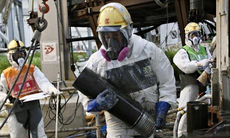 Workers constructing an ice wall at the Fukushima Daiichi nuclear power plant, crippled by a tsunami in March 2011. Photograph: Kimimasa Mayama/AFP/Getty Images