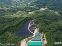 Aerial view of nuclear waste storage area in the mountainous forests of Iitate, Fukushima prefecture in Japan (Oct 2017).