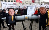 BERLIN, GERMANY - NOVEMBER 18:  An activist with a mask of Kim Jong-un, chairman of the Workers' Party of Korea and supreme leader of North Korea (L), and another with a mask of U.S. President Donald Trump, march with a model of a nuclear rocket during a demonstration against nuclear weapons on November 18, 2017 in Berlin, Germany. About 700 demonstrators protested against the current escalation of threat of nuclear attack between the United States of America and North Korea. The event was organized by peace advocacy organizations including the International Campaign to Abolish Nuclear Weapons (ICAN), which won the Nobel Prize for Peace this year.  (Photo by Adam Berry/Getty Images)