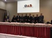 Mesa com organizadores e palestrantes