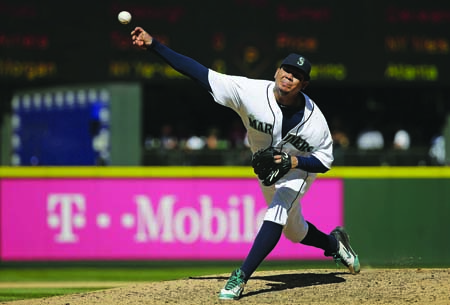 d-Seattle Mariners starti7ng pitcher Felix Hernandez throws against the Texas Rangers during--AP Photo-Ted S. Warren