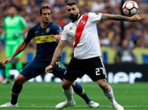 Izquierdoz e Pratto marcaram para Boca e River no empate de ontem. Foto: Divulgação/Conmebol