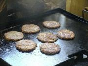 Burgers cooking on hotplate