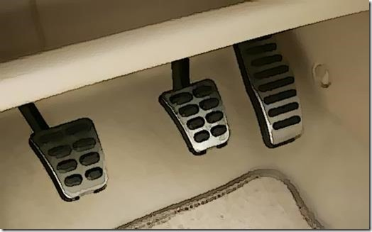 Car pedals in footwell