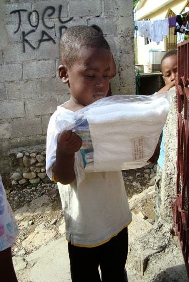 Delivery of basic hygiene supplies in Haiti. Image from Serving with Smiles