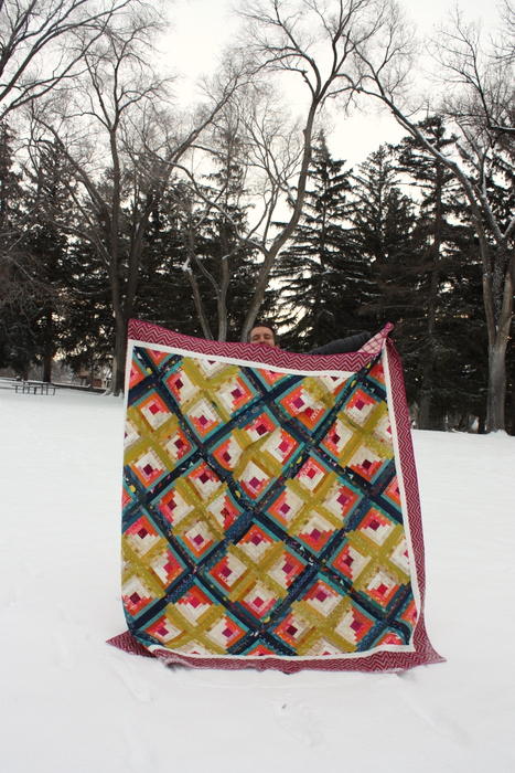 Husband holding quilt Diary of a Quilter
