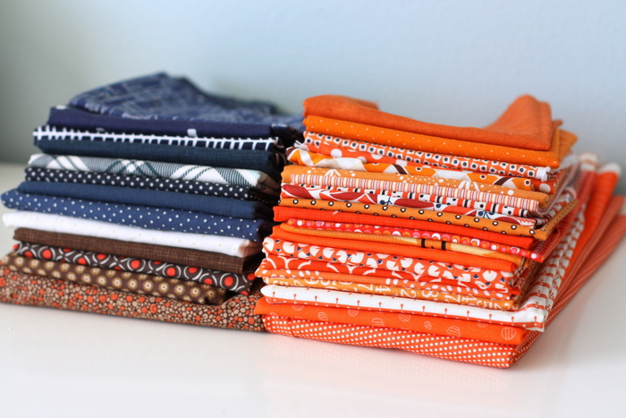 Orange navy brown fabric