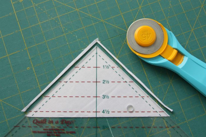 Half Square Triangle Short Cuts featured by top US quilting blog, Diary of a Quilter: Short-cuts for making and squaring-up multiple Half Square Triangle Quilt Blocks at once. Video tips and time-saving tutorial.