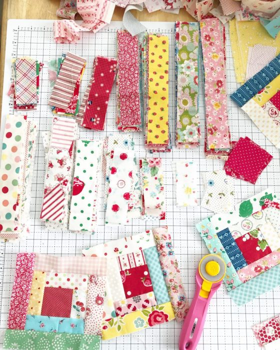 Use fabric scraps to piece a Log Cabin quilt