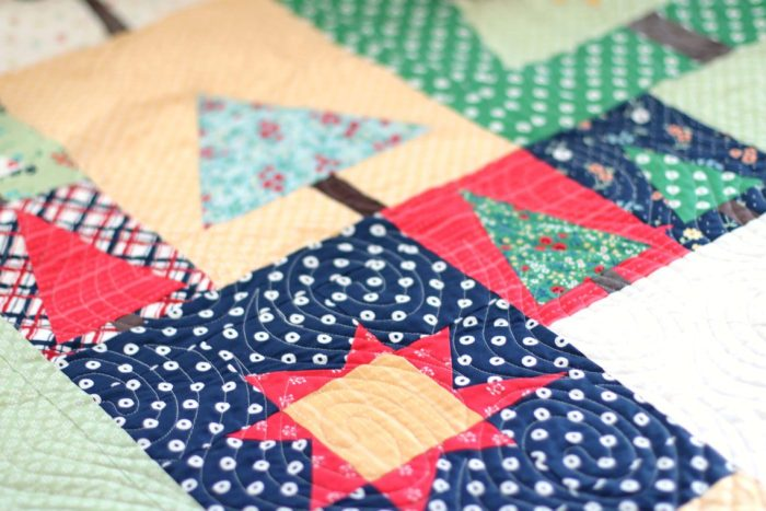 Pine Hollow Patchwork Forest Quilt Along Week 4 by popular Utah quilting blog, Diary of a Quilter: image of a patchwork forest quilt.