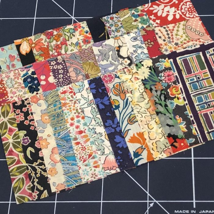 Scrappy Liberty Patchwork Pincushion by Guest May Chappell by popular quilting blog, Diary of a Quilter: image of stitched together Liberty Lawns fabric.