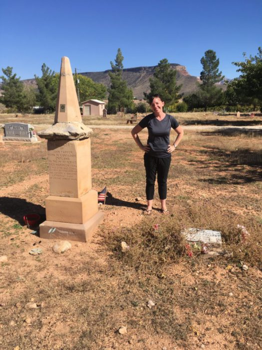 The Tale of a Pioneer Quilt, Cut in Two by popular quilting blog, Diary of a Quilter: image of a woman standing in a cemetery in Virgin, Utah.