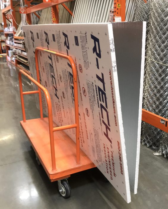 How to Build a Quilt Design Wall by Christa Watson by popular quilting blog, Diary of a Quilter: image of two foam core insulation boards on a orange push cart.