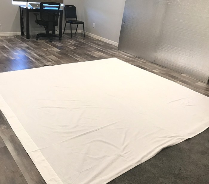 How to Build a Quilt Design Wall by Christa Watson by popular quilting blog, Diary of a Quilter: image of two foam core insulation boards covered in a king size white flannel sheet.